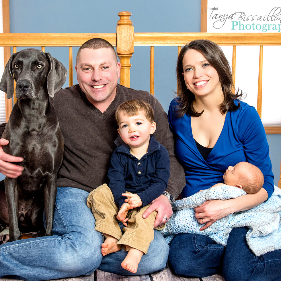 Newborn baby with family and dog